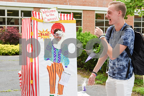060917 Wesley Bunnell   Staff Bristol Eastern High School held its second annual SAT Carnival on Friday. The carnival featured face painting, cotton candy, pie throwing, duct taping, and a dunk tank for Juniors who took the SAT's. Principal Carly Fortin gets a pie thrown to her face by student Peter Jeski-Robinson.