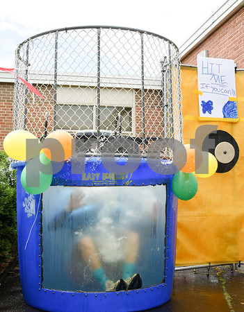 060917 Wesley Bunnell | Staff Bristol Eastern High School held its second annual SAT Carnival on Friday. The carnival featured face painting, cotton candy, pie throwing, duct taping, and a dunk tank for Juniors who took the SAT's. Assistant Principal Mike Higgins sits submerged in the dunk tank.