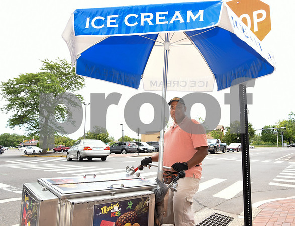 060917 Wesley Bunnell | Staff Jose Nunes mans his ice cream cart Delicias Ice Cream III on South Main St on a warm Friday afternoon.