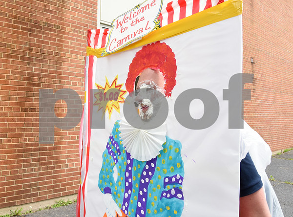 060917 Wesley Bunnell | Staff Bristol Eastern High School held its second annual SAT Carnival on Friday. The carnival featured face painting, cotton candy, pie throwing, duct taping, and a dunk tank for Juniors who took the SAT's. Tech Ed teacher Michael LeClair after getting a pie in the face.