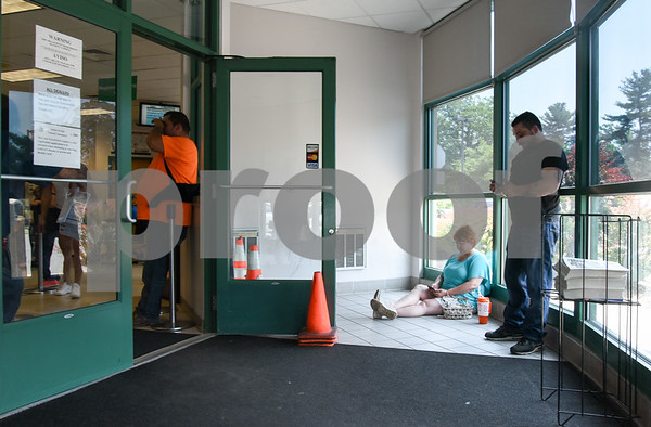 061317 Wesley Bunnell | Staff Cheryl Desjardins sits in the lobby of the DMV on Mountain Rd for several hours with son Ryan Desjardins on Tuesday afternoon with all seating taken inside the building.