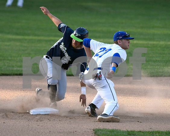 6/14/2017 Mike Orazzi | Staff Bristol Blues' Jake Frasca (27) tags out the Bravehearts' Thomas Walraven (2) at second base Wednesday night at Muzzy Field.