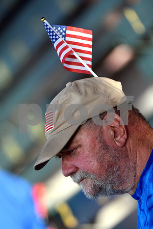 6/14/2017 Mike Orazzi | Staff Bristol Blues' fan Charles Skridulis wears two flags on Flag Day while at Wednesday night's baseball game with the Bravehearts at Muzzy Field.