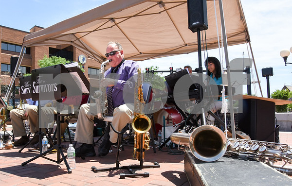 061417 Wesley Bunnell | Staff Greg Butko of The Survivors Swing Band plays during the band's concert for the lunchtime crowd on Wednesday at Central Park.