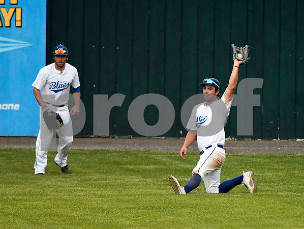 6/14/2017 Mike Orazzi | Staff Bristol Blues' Cooper Mrowka (26) makes a diving catch Wednesday night at Muzzy Field.