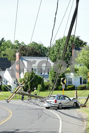 061417 Submitted photos from Stanley A Mazda Protege Wagon crashed into a utility pole on Stanley St near the intersection with Lyle Rd on Wednesday afternoon knocking out power to the area.