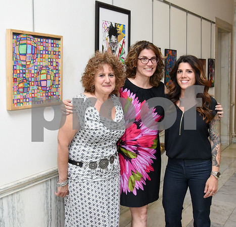 061417 Submitted photos from Stanley The New Britain High School Art Show & Satellite Career Academy Photography Exhibition held an opening reception on Wednesday evening at city hall. Art teacher Andrea Russo, L, Fine Arts Department Chair Karen Soccodato & art teacher Kelly LaVette.