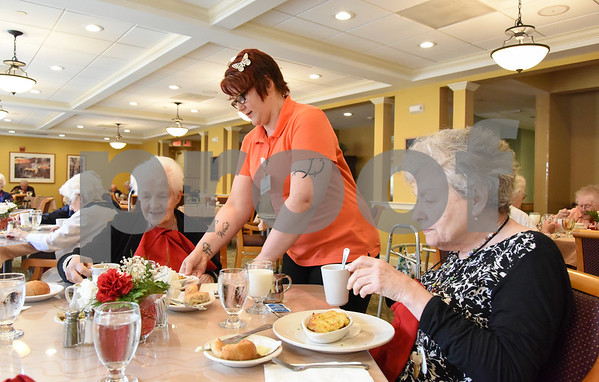 061517 Wesley Bunnell | Staff Arbor Rose residents sit enjoying their lunch on Thursday June 15. Pauline Gadzik, L, is served her lunch by a member of the staff as she sits next to Gail Westermeyer.