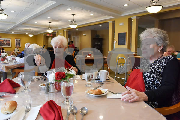 061517 Wesley Bunnell | Staff Arbor Rose residents sit enjoying their lunch on Thursday June 15. Pauline Gadzik, L, pours her coffee as she sits next to Gail Westermeyer.