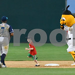 051817  Wesley Bunnell | Staff  New Britain Bees vs the Bridgeport Bluefish on Thursday evening. A young fan races Sting around the bases.