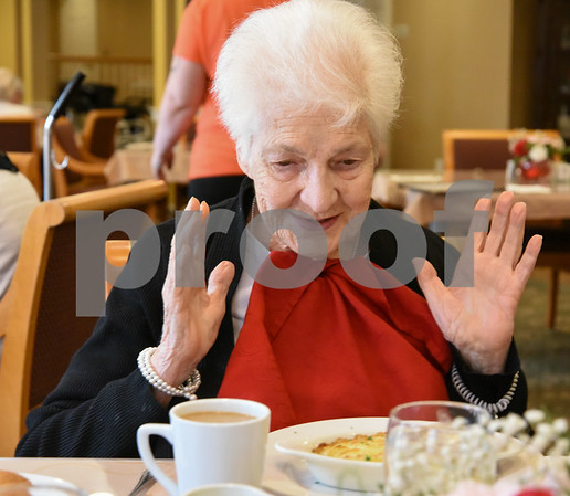 061517 Wesley Bunnell | Staff Arbor Rose residents sit enjoying their lunch on Thursday June 15. Pauline Gadzik who goes by the name Niki is excited by the days choice of shepard's pie.