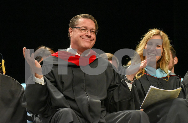 062017 Wesley Bunnell | Staff Newington High School held their 2017 commencement at the Oakdale Theatre on Tuesday evening. Retiring Principal Jim Wenker motions as he takes his seat following an emotional speech to the class.