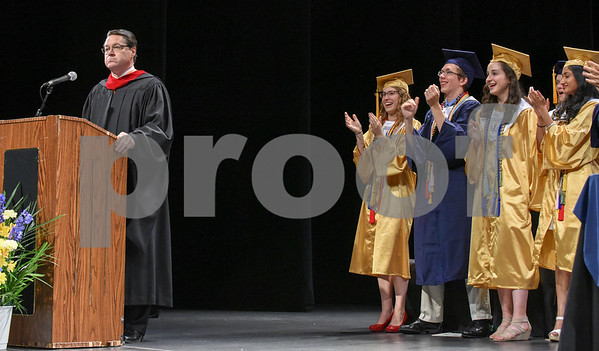 062017 Wesley Bunnell | Staff Newington High School held their 2017 commencement at the Oakdale Theatre on Tuesday evening. Principal Jim Wenker receives a standing ovation from the crowd including President of the Student Council Emily Carle, Class President Jeremy Rippel, Class Valedictorian Teodora Markova, Class Salutatorian Ariya Jacob.