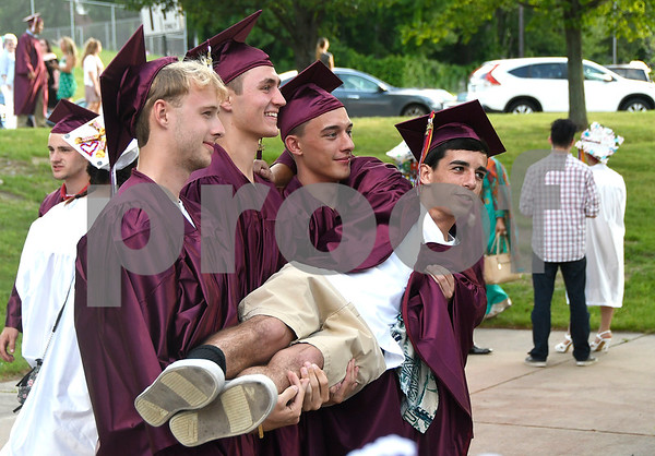 6/21/2017 Mike Orazzi | Staff Bristol Central High graduate Max Naranjo held by fellow grads Quinn O'Donnell, Mike Lemke and Nevin Tulloch during Wednesday night's ceremony in Bristol.