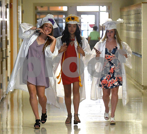 6/21/2017 Mike Orazzi | Staff Bristol Central High graduates Brianna Hamel,Ashley Yung and Meghan Hamel during Wednesday night's ceremony in Bristol.