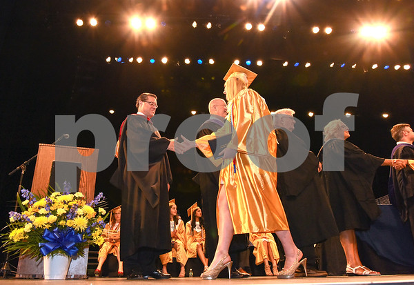 062017 Wesley Bunnell | Staff Newington High School held their 2017 commencement at the Oakdale Theatre on Tuesday evening. Principal Jim Wenker shakes hands with graduate Lauren Brooks.