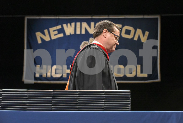 062017 Wesley Bunnell | Staff Newington High School held their 2017 commencement at the Oakdale Theatre on Tuesday evening. Retiring Principal Jim Wenker walks past the stacks of diplomas after delivering an emotional speech to the class.
