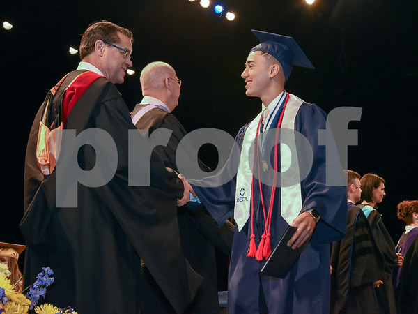 062017 Wesley Bunnell | Staff Newington High School held their 2017 commencement at the Oakdale Theatre on Tuesday evening. Principal Jim Wenker shakes hands with Kevin Bilbraut.