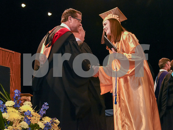 062017 Wesley Bunnell | Staff Newington High School held their 2017 commencement at the Oakdale Theatre on Tuesday evening. Principal Jim Wenker shakes hands with graduate Emily Austin.