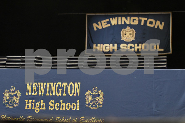 062017 Wesley Bunnell | Staff Newington High School held their 2017 commencement at the Oakdale Theatre on Tuesday evening. Stacks of diplomas sit on the front of the stage.