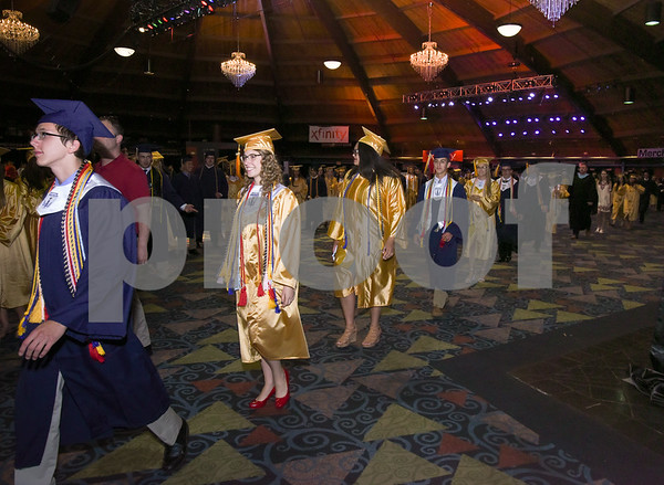 062017 Wesley Bunnell | Staff Newington High School held their 2017 commencement at the Oakdale Theatre on Tuesday evening. Class President Jeremy Rippel and President of the Student Council Emily Carle walk through the lobby prior to the start.