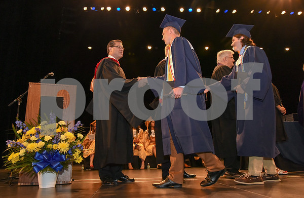 062017 Wesley Bunnell | Staff Newington High School held their 2017 commencement at the Oakdale Theatre on Tuesday evening. Principal Jim Wenker shakes hands with graduate Patrick Callahan.