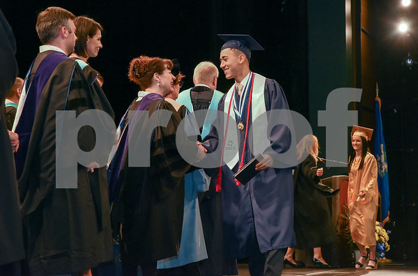 062017 Wesley Bunnell | Staff Newington High School held their 2017 commencement at the Oakdale Theatre on Tuesday evening. Graduate Kevin Bilbraut receives his diploma.