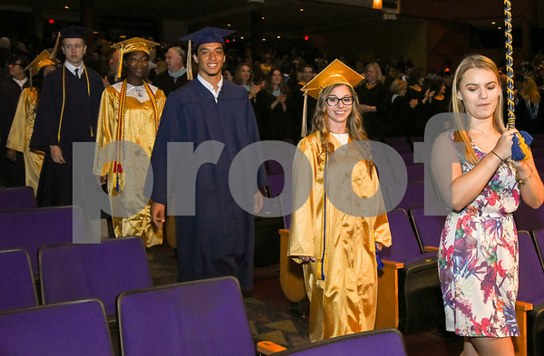 062017 Wesley Bunnell | Staff Newington High School held their 2017 commencement at the Oakdale Theatre on Tuesday evening. Students march past parents and other guests as they find their seats for graduation.