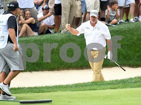 062517 Wesley Bunnell | Staff The final round at the Travelers Championship on Sunday afternoon. Book Weekley fist pumps after a chipping in from a sand trap for birdie on the 8th hole.