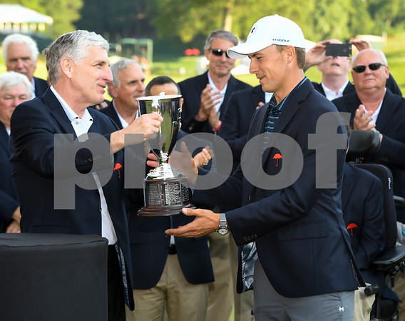 062517 Wesley Bunnell | Staff Action from final day of the Travelers Championship on Sunday. Jordan Spieth would go on to hole out from the bunker on the first playoff hole against Dustin Berger to win the 2017 Travelers Championship. Travelers CEO Alex Schnitzer presents Jordan Spieth with his championship trophy.