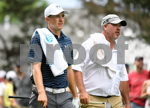 062517 Wesley Bunnell | Staff Action from final day of the Travelers Championship on Sunday. Jordan Spieth would go on to hole out from the bunker on the first playoff hole against Dustin Berger to win the 2017 Travelers Championship. Jordan Spieth walks down the fairway with Boo Weekley.