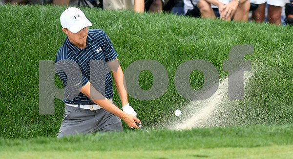 062517 Wesley Bunnell | Staff The final round at the Travelers Championship on Sunday afternoon. Jordan Spieth out of a sand trap onto the green.