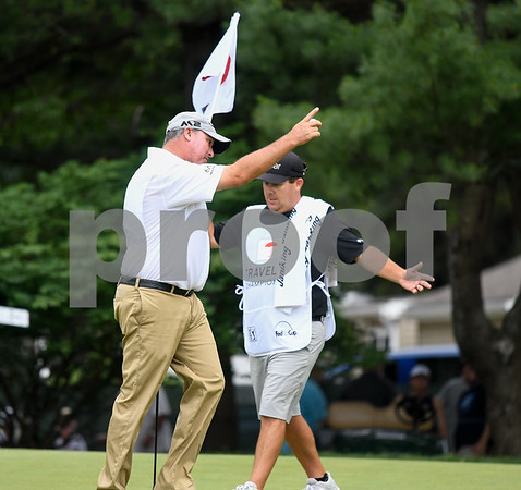 062517 Wesley Bunnell | Staff The final round at the Travelers Championship on Sunday afternoon. Book Weekley points to the crowd after making a tough putt.