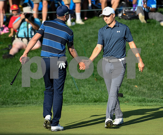 062517 Wesley Bunnell | Staff Action from final day of the Travelers Championship on Sunday. Jordan Spieth would go on to hole out from the bunker on the first playoff hole against Dustin Berger to win the 2017 Travelers Championship. Jordan Spieth , R, shakes hands with Dustin Berger just before Berger's putt attempt.