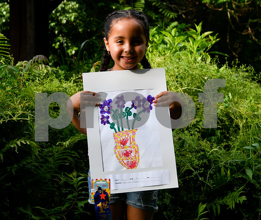 062317 Wesley Bunnell | Staff The Art League of New Britain along with the New Britain Youth Museum held an art show titled Summer Solstice Sculpture Walk on Friday June 23. Six year old Faith Morales holds up her artwork which took first place for the kIndergarten age group.