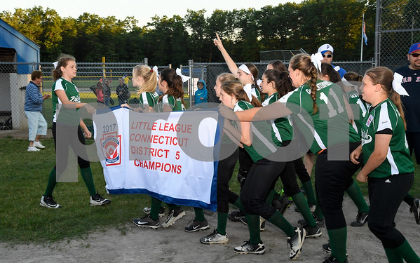 062617 Wesley Bunnell | Staff Bristol defeated Berlin on Monday evening in Plainville to claim the Little Leage District 5 Softball Championship. The Bristol team takes the banner for a victory lap around the field.