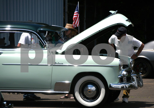 6/10/2017 Mike Orazzi | Staff Bob Nardiello looks over a 1950 Chevy during the Wings and Wheels Festival at Robertson Airport in Plainville Saturday.