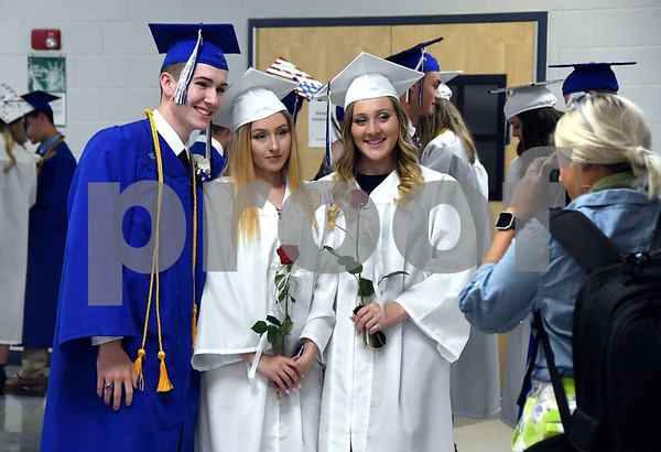 6/15/2017 Mike Orazzi | Staff Plainville High School graduates Stephen Adam Biggar, Jessica Varrato and Kyli Petillo pose at the graduation ceremony Thursday evening.