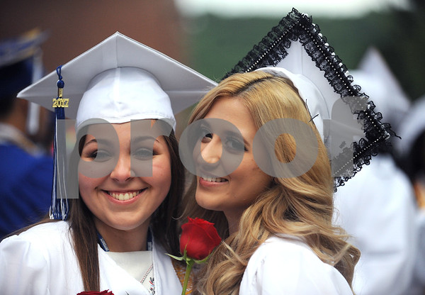 6/15/2017 Mike Orazzi | Staff Plainville High School graduates Karolina Zalewski and Melisa Selimovic Thursday evening.