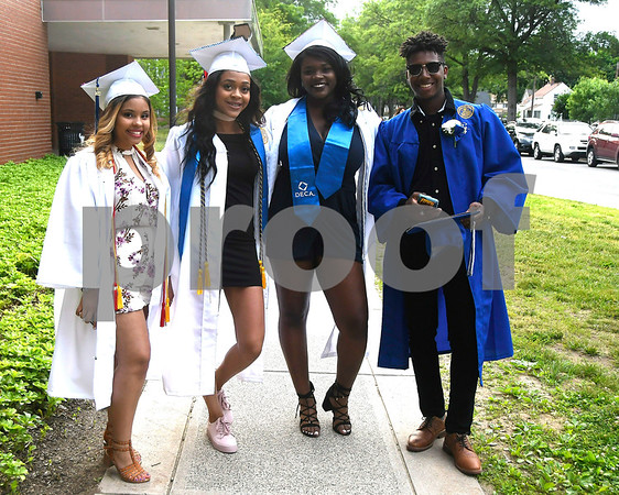 6/15/2017 Mike Orazzi | Staff Plainville High School graduates Lilly Morales, Damari Jackson, Keiyana Hairston and Darien Rodriguez at the graduation ceremony Thursday evening.