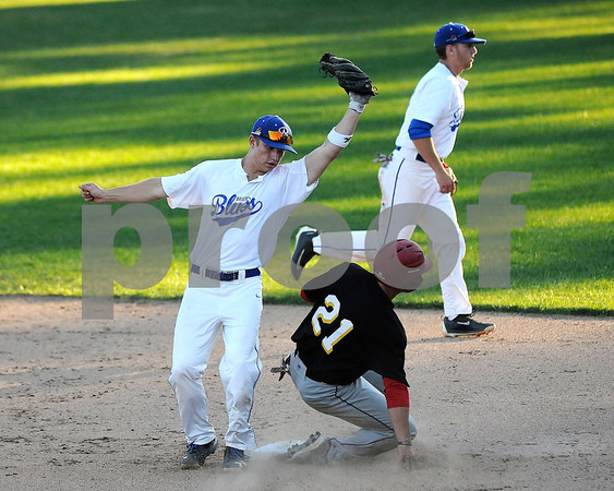 6/20/2017 Mike Orazzi | Staff Bristol Blues' Mark Tumosa (6) as the Pittsfield Suns' Andre Marrero (21) steals second base at Muzzy Field Tuesday night.