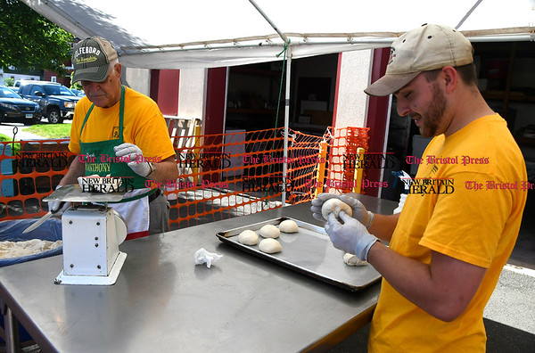 6/1/2017 Mike Orazzi | Staff Jack Law and Spark Carpenter measure dough for fried dough during the St. Anthony's Italian Festival Friday evening.