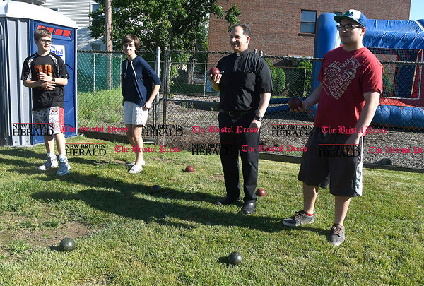 6/1/2017 Mike Orazzi | Staff Sean Rozmajzl and his sister Ava along with Father Alphonso Fontana and his nephew Andrew Fontana while playing bocce ball during the St. Anthonys Italian Festival Friday evening.