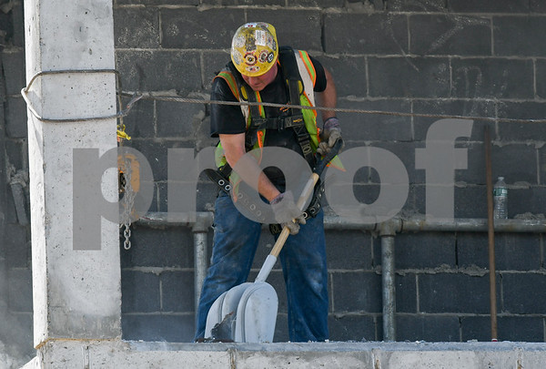 062217 Wesley Bunnell | Staff Construction continues on the $62M Willard & DiLoreto project at CCSU on Thursday afternoon. A worker scrapes up concrete debris from Willard Hall.