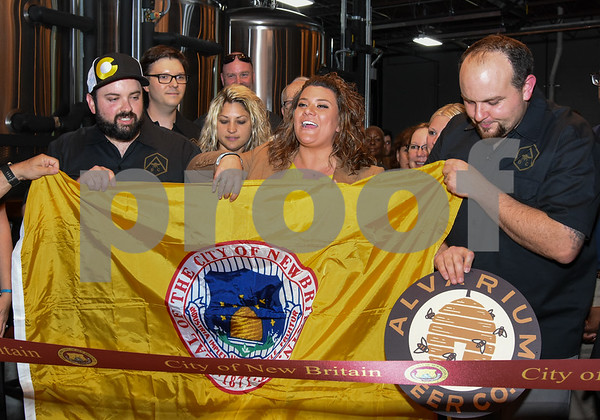 062317 Wesley Bunnell | Staff Alvarium Beer Company held a ribbon cutting on Friday and became the first brewery open in New Britain since the mid 1950's. Holding a City of New Britain flag is Alvarium Beer co-founder Chris DeGasero, co-founder Brian Bugnacki, Mayor Erin Stewart co-founder Mike Larson.