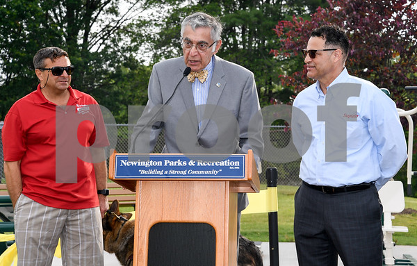062917 Wesley Bunnell | Staff Newington Parks and Recreation Superintendent Bill DeMaio , L, stands next to Mayor Roy Zartarian and Saputo plant manager Roque Lopez as Zartarian reads a proclamation honoring Saputo's commitment to the Town of Newington. A ribbon cutting for the newly installed Saputo Fitness Center was held immediately following the ceremony.