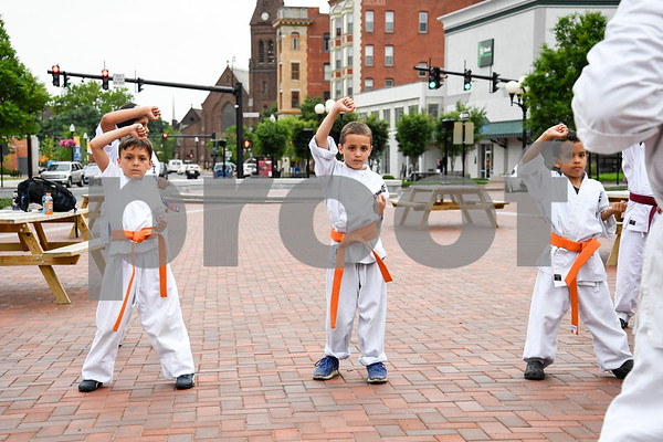 062917 Wesley Bunnell | Staff New Britain Judo and Karate School held an outdoor class in Central park on Thursday evening. Isaac Dabkowski, L, Jacob Prokop and Ethan Canales follow instructor Carl Messina, R.