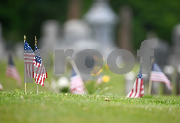 062917 Wesley Bunnell | Staff American flags in the veterans' section of Fairview Cemetery in New Britain on Thursday afternoon.