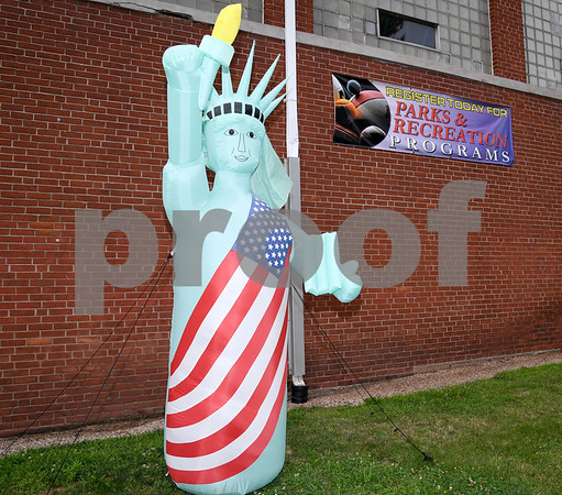062917 Wesley Bunnell | Staff An inflatable Statue of Liberty outside of the Parks and Recreation Department in Newington on Thursday afternoon.