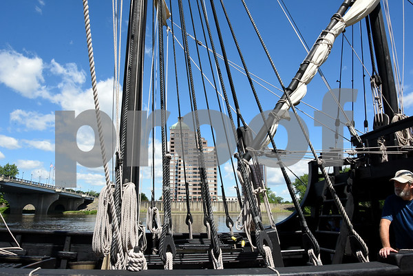 060717 Wesley Bunnell | Staff A large apartment building in East Hartford is visible through the rigging of a replica of Christopher Columbus' ship the Nina at dock on the Hartford riverfront on Wednesday afternoon.